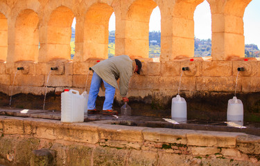 Man next to the fountain