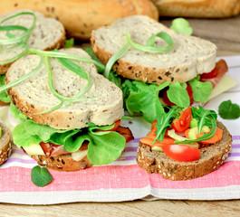 Vegetarian sandwich and ham sandwich