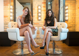 Two Attractive Models in Salon Chairs