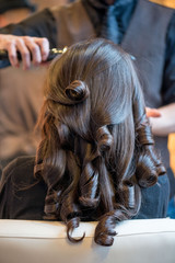 Young woman getting her hair done in a trendy hair salon