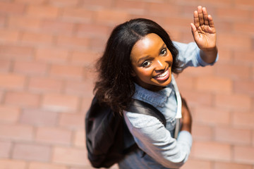 african american student waving goodbye