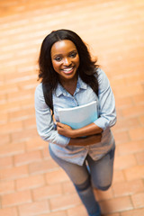 young african american college girl walking on campus
