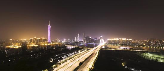 traffic blur motion on bridge with night cityscape background