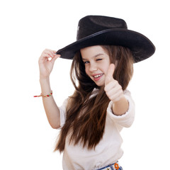Portrait of a beautiful little girl in a black cowboy hat