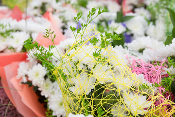 many  bouquets  in bright packages