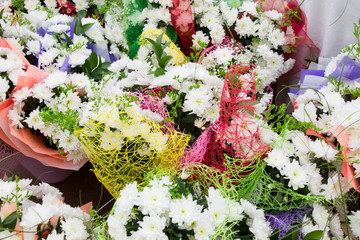 bouquets of chrysanthemums in bright packages