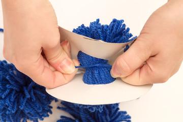 handmade tie pompom middle thread