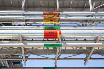 pipes under the roof with colored  mark and black arrows