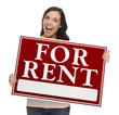 Mixed Race Female Holding For Rent Sign on White