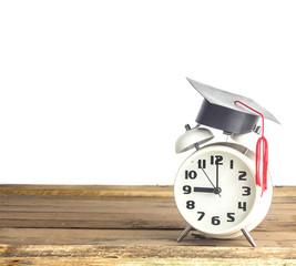 Graduation cap on clock