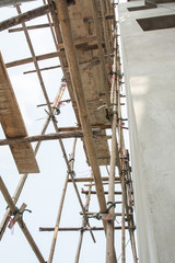 Wooden with bamboo scaffolding for construction site