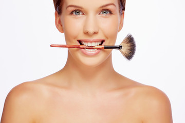 Girl with cosmetic brush