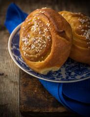 Fresh sugar buns on a blue plate with