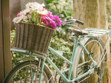 Vintage bicycle with flowers in basket - 77974542