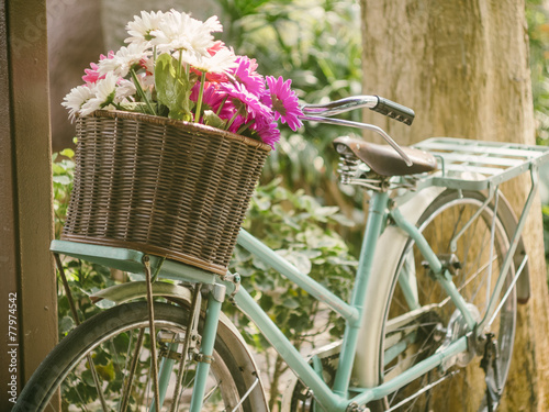 Fotobehang Fiets Vintage bicycle with flowers in basket