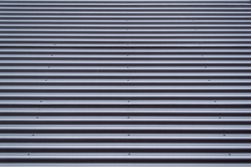 Grey corrugated metal surface pattern