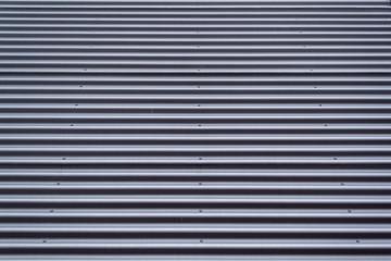 Grey corrugated metal surface pattern