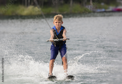 Papiers peints Nautique motorise Blonde Boy learning to waterski on a lake