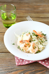 Risotto with shrimp and dill on a plate