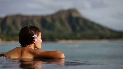 Holiday woman swimming at beach on Hawaii travel
