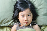 Fototapety Little asian sick girl under blanket with temperature in mouth