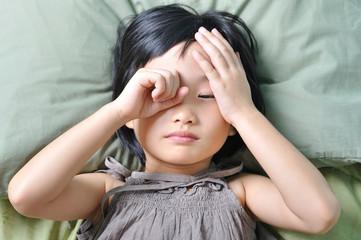 wake up of sleepy asian little child