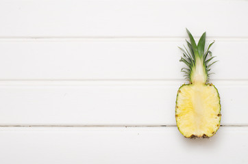 Lonely pineapple on white wood