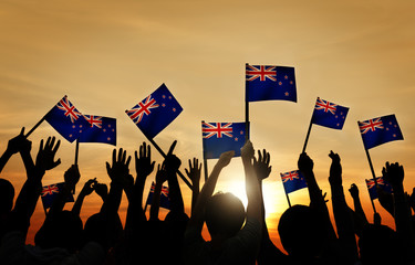 Silhouettes People Holding Flag New Zealand Concept
