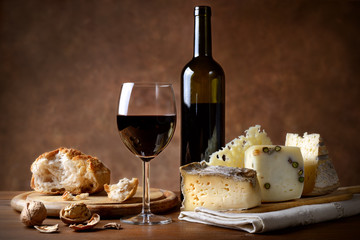 Bread, cheese, red wine and walnuts