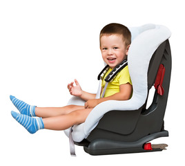 three-year-old boy sits auto children's chair, isolated
