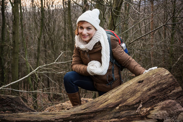 Young female tourist in a deciduous forest
