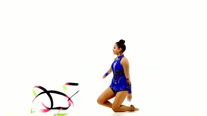 Girl gymnast with color ribbon