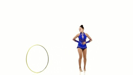 Outdoor portrait of young beautiful  woman gymnast  with hula