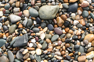 Texture of variety of pebbles on beach