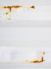 White corrugated iron metal texture with Rust spotted on surface