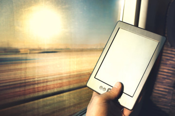 reading digital book while travelling
