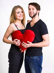Happy couple with red heart
