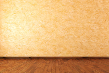 Empty room with stucco wall and wooden floor