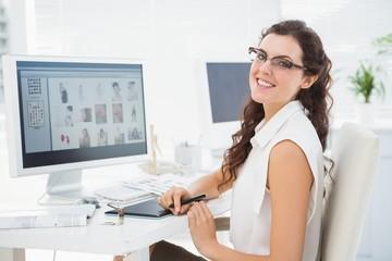 Portrait of smiling businesswoman using digitizer