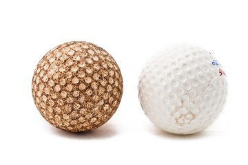 close up shot of brown and a white golf ball