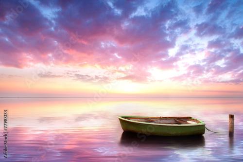 canvas print picture einsames Fischerboot am Strand