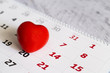 Red heart and calendar, love month - 77984173