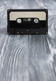 Music concept. Black audio cassette