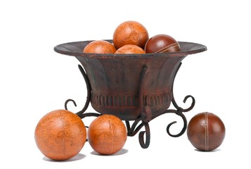 view of a antique container with different orange and red balls