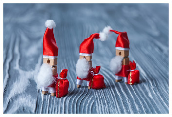 Christmas. clothespin. 3 Santa Claus with a bags of gifts