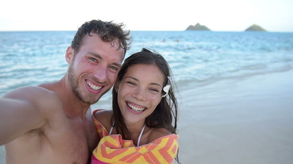 Selfie - beach couple taking self portrait video