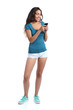Full body of a teenager girl texting in a smart phone - 77987742