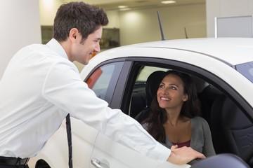 Salesperson speaking with happy client