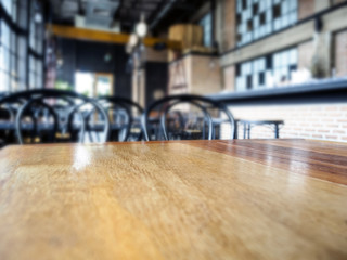Top of Wooden table Bar Blurred Restaurant background