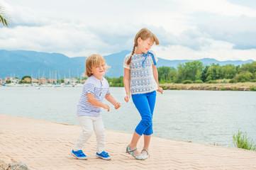 Adorable kids having fun outdoors